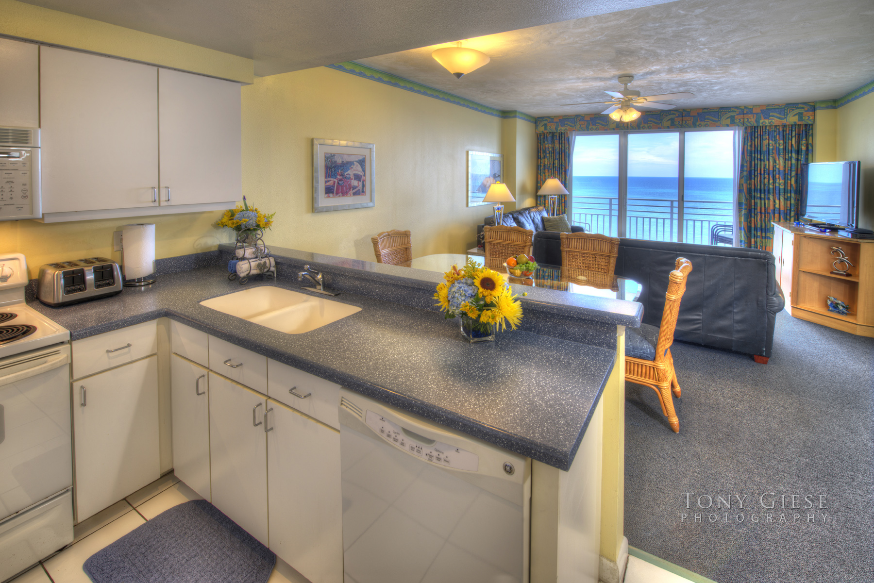Wyndham Ocean Walk Resort newly remodeled kitchen area with all the latest appliances and a ocean view of Daytona Beach, Florida. Photography by Tony Giese