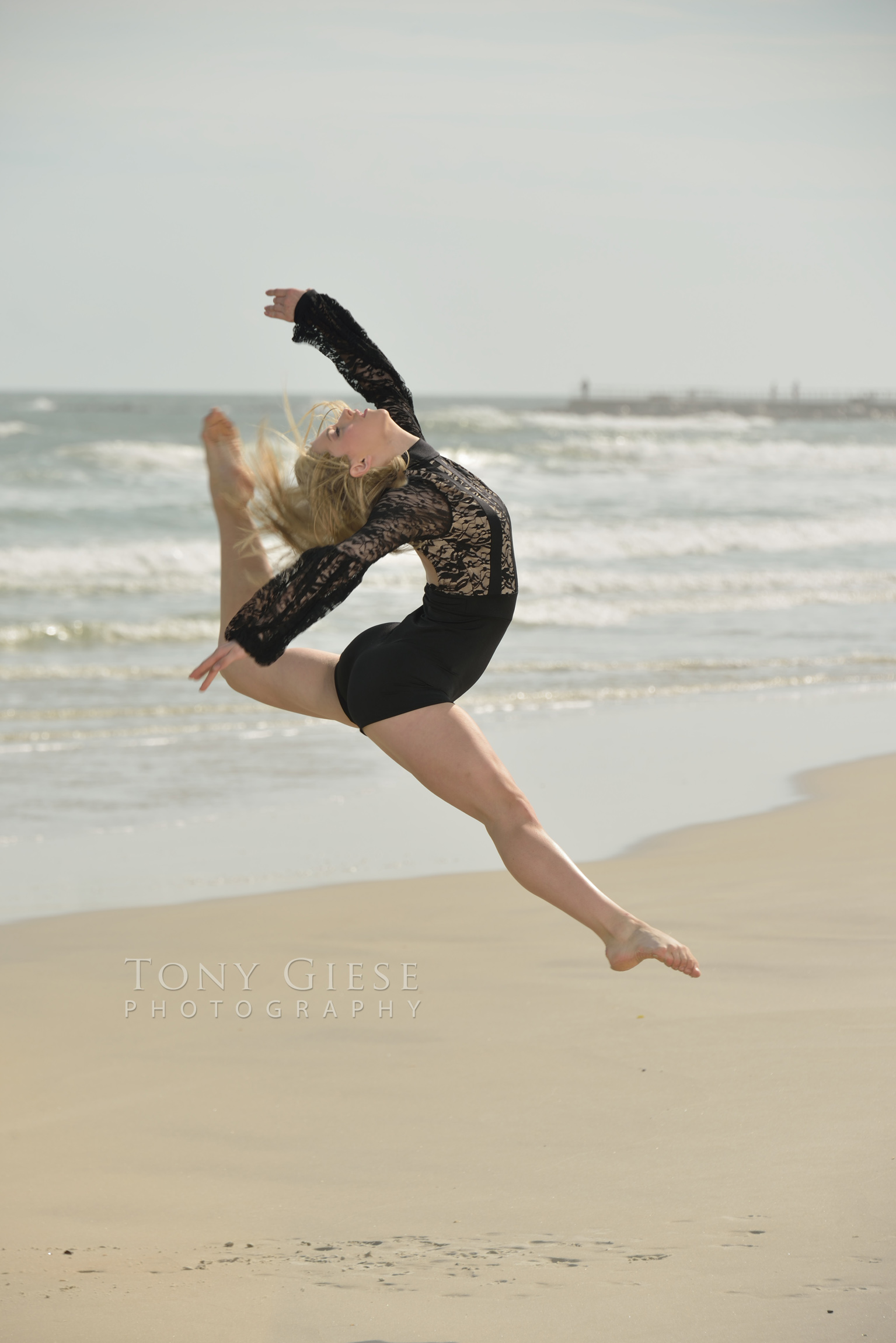 Dancing on Ponce Inlet Beach, Florida by Tony Giese Photography.