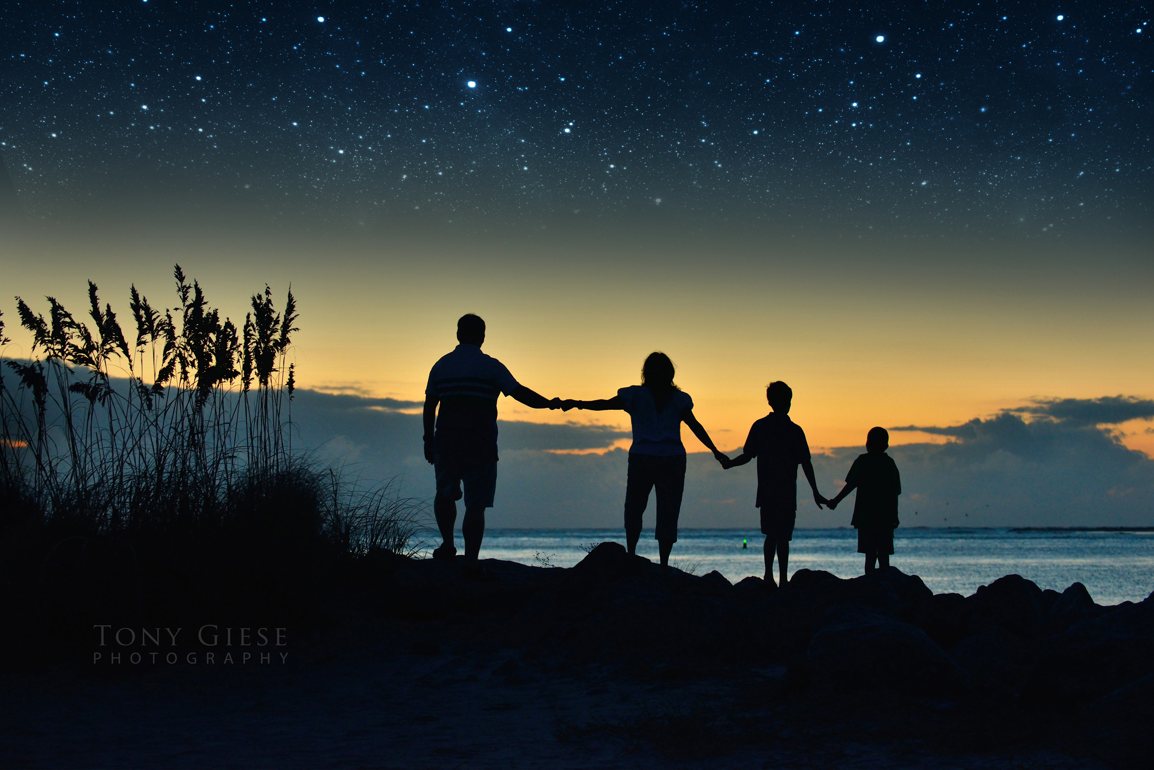 Pre dawn family portrait at Lighthouse Point Park, Florida.