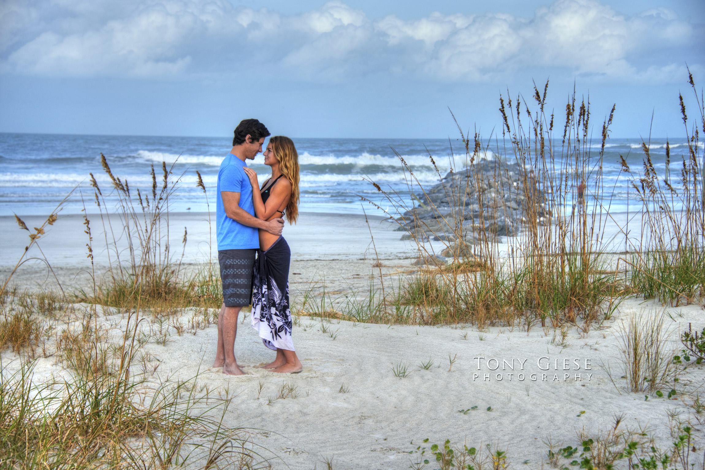 Young couple enjoying New Smyrna Beach, Florida. Photo by Tony Giese Photography