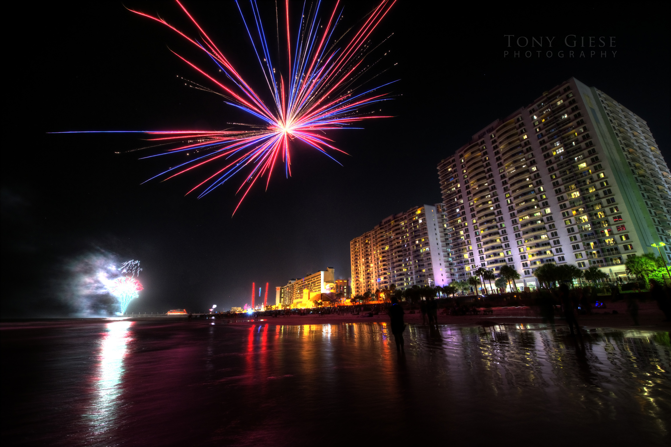 Fireworks in the far distance off the Main Street Pier  illuminating the ocean on Daytona Beach.