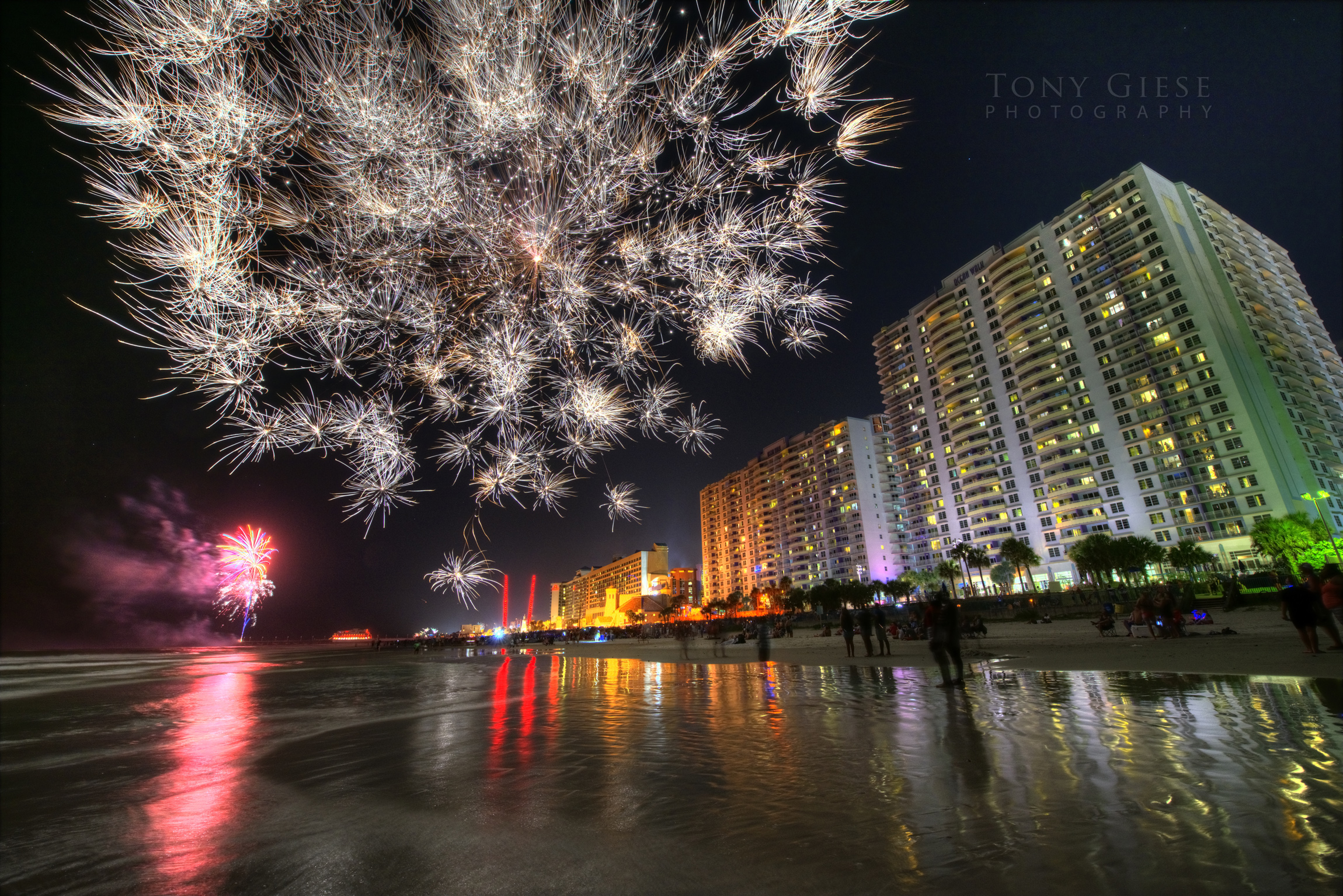 The night sky full of fireworks near Wyndham Ocean Walk resort on Daytona Beach.