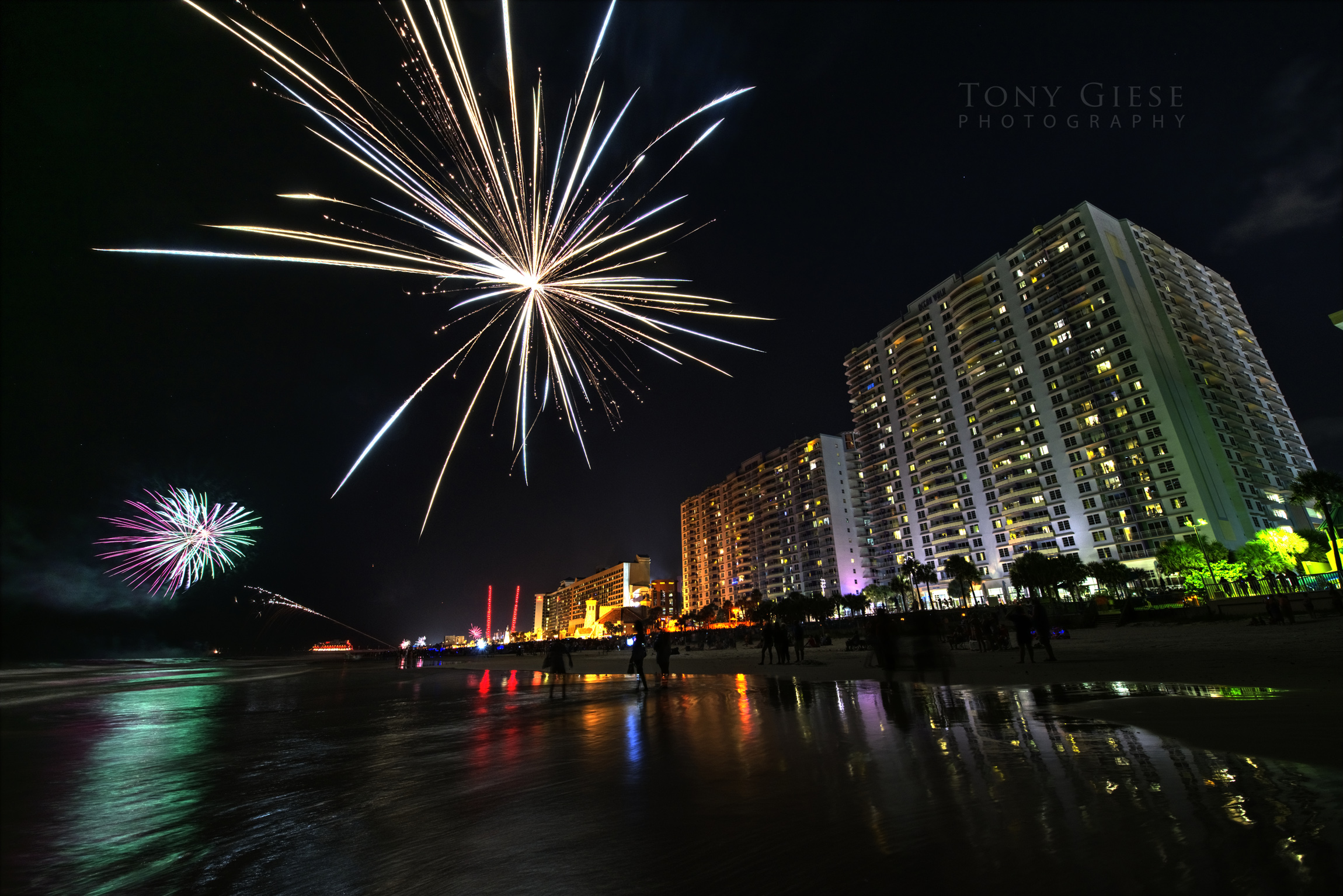 Wyndham Ocean Walk resort with fireworks on Daytona Beach, Florida.
