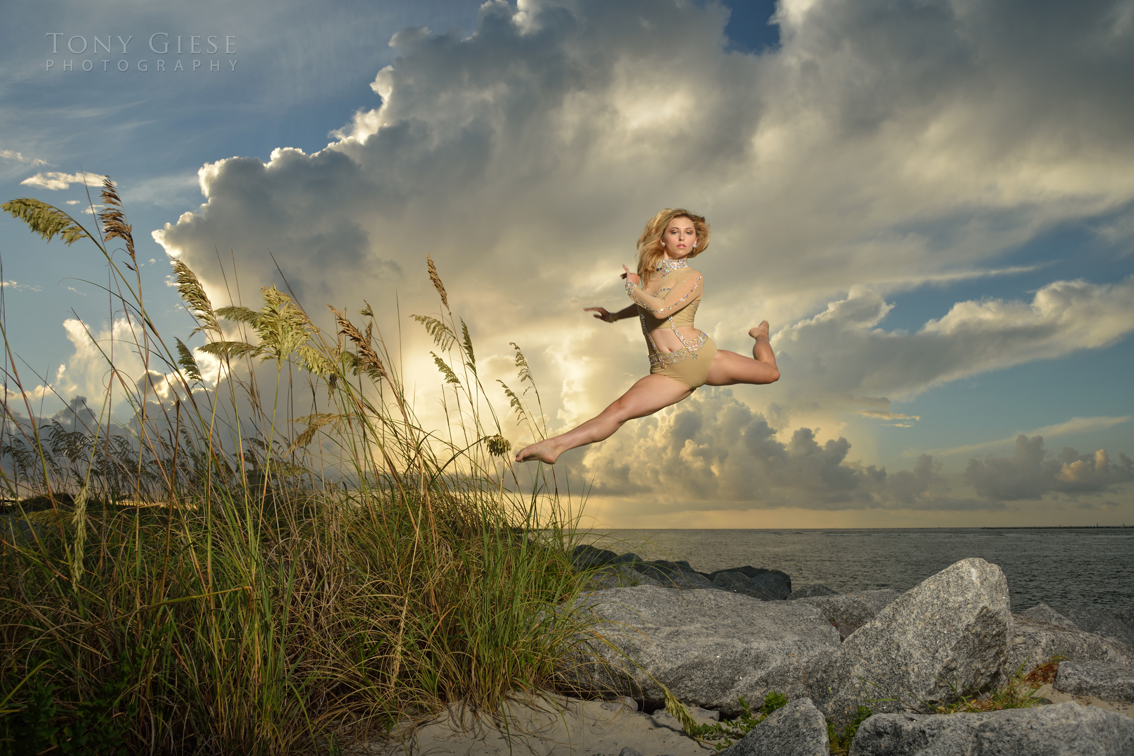 Tallee dancing move of jumping rocks on ocean, Ponce Inlet, Florida. Photography by Tony Giese