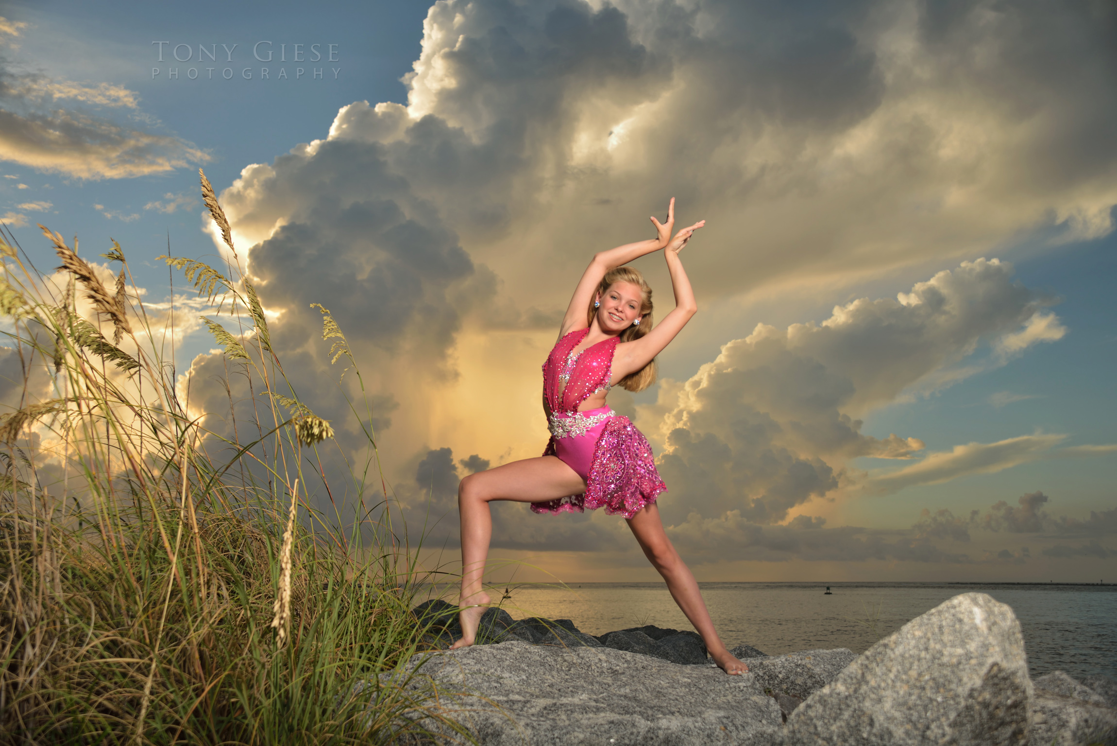 Taya's dance pose on the rock jetties, Ponce Inlet, Florida. Photograph by Tony Giese Photography