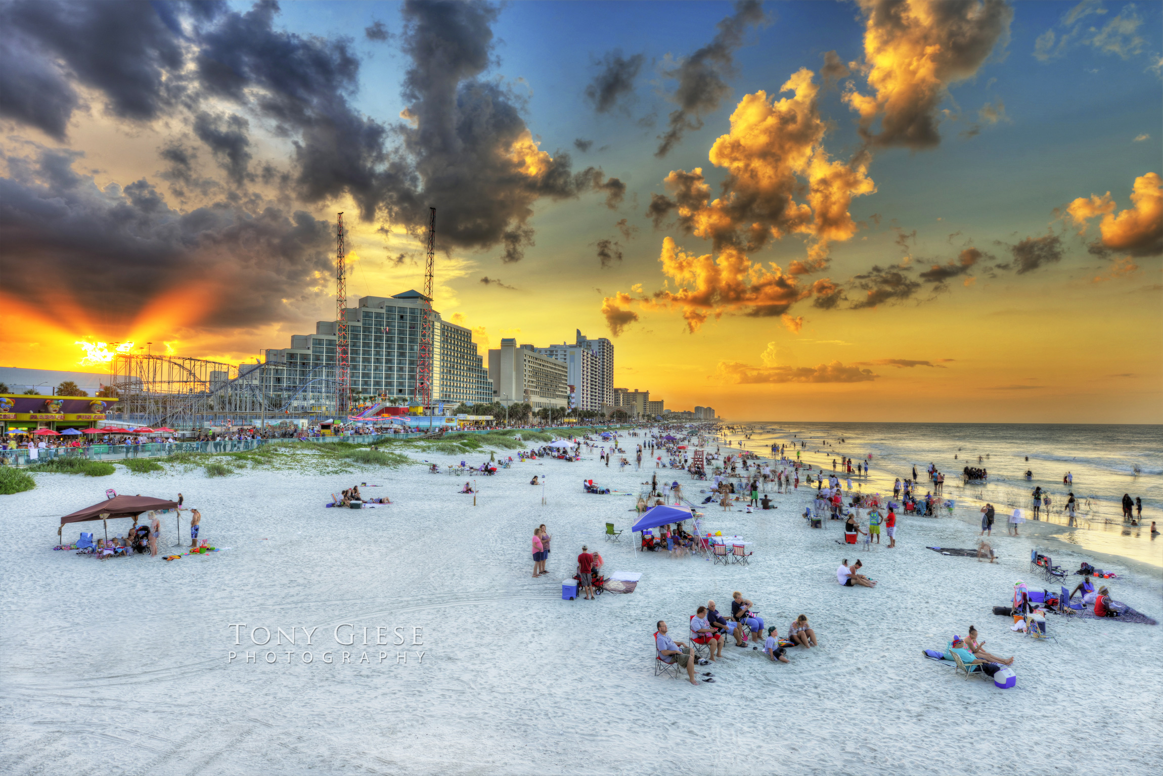 Beach goers enjoy Daytona Beach white sands
