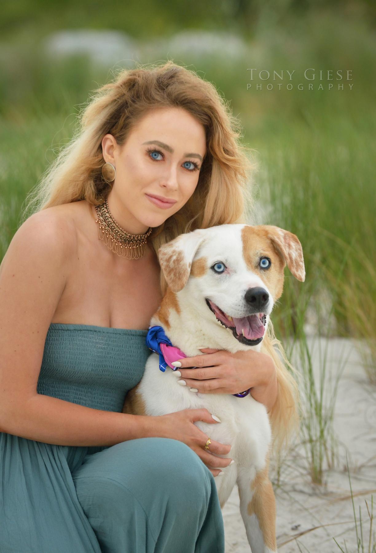 Portrait of blue eyed dog and owner on Daytona Beach, FL