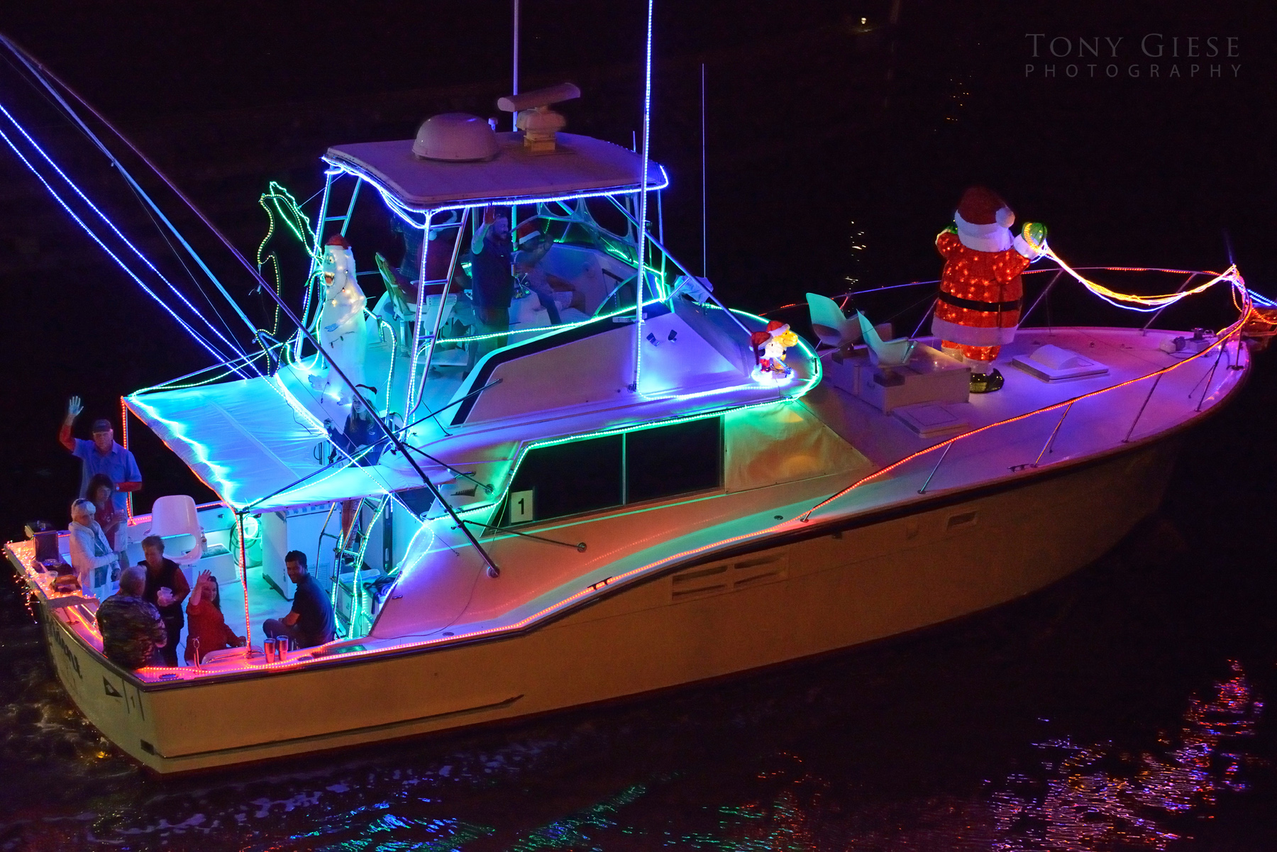 Partying with santa on the brilliantly decorated boat parading down the Halifax River, Daytona Beach, Florida.