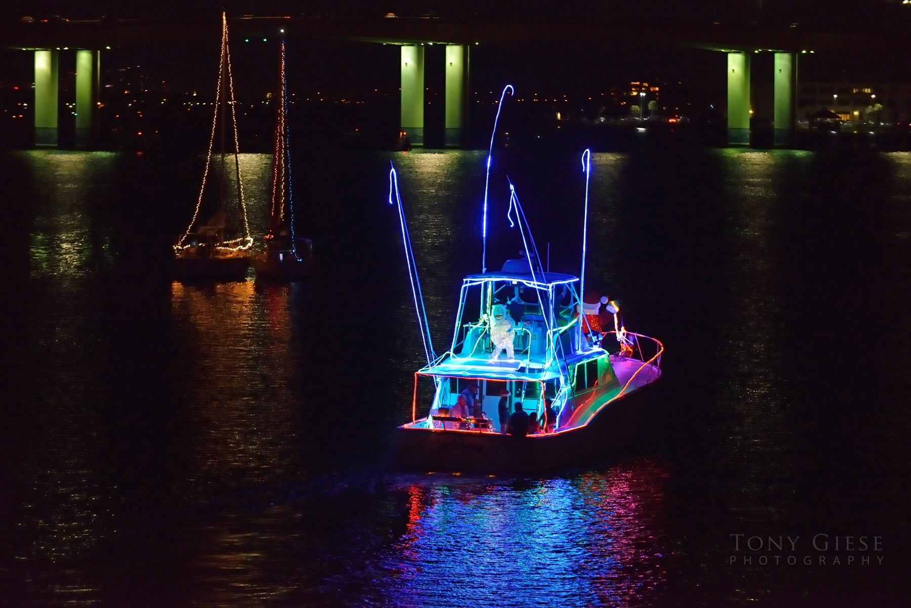 Lighted boat in Christmas Parade heading for ISB Bridge, Daytona Beach, Florida.