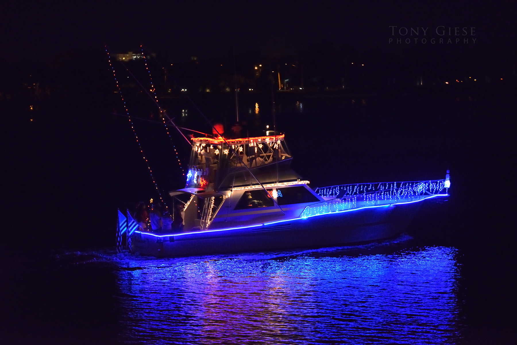 The boats colorful lighted reflections stand out in the darkness of the Halifax River, Daytona Beach, Florida.