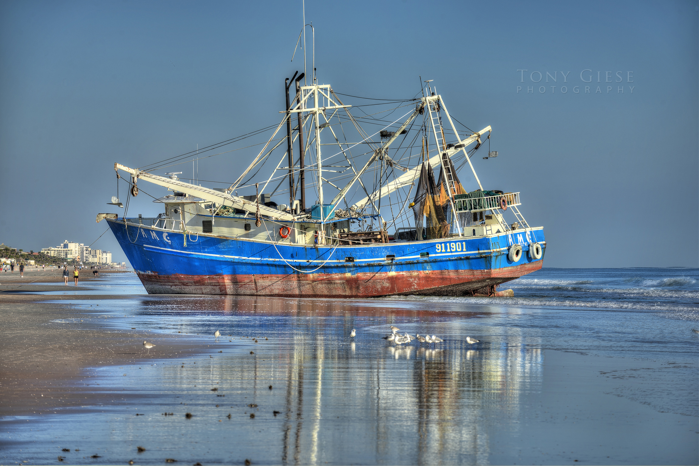 A shrimp boat ran aground in Ormond Beach for almost two weeks before a barge pulled it back out to sea. Interesting beach attraction for tourist and all local residents as it rested on the shoreline.