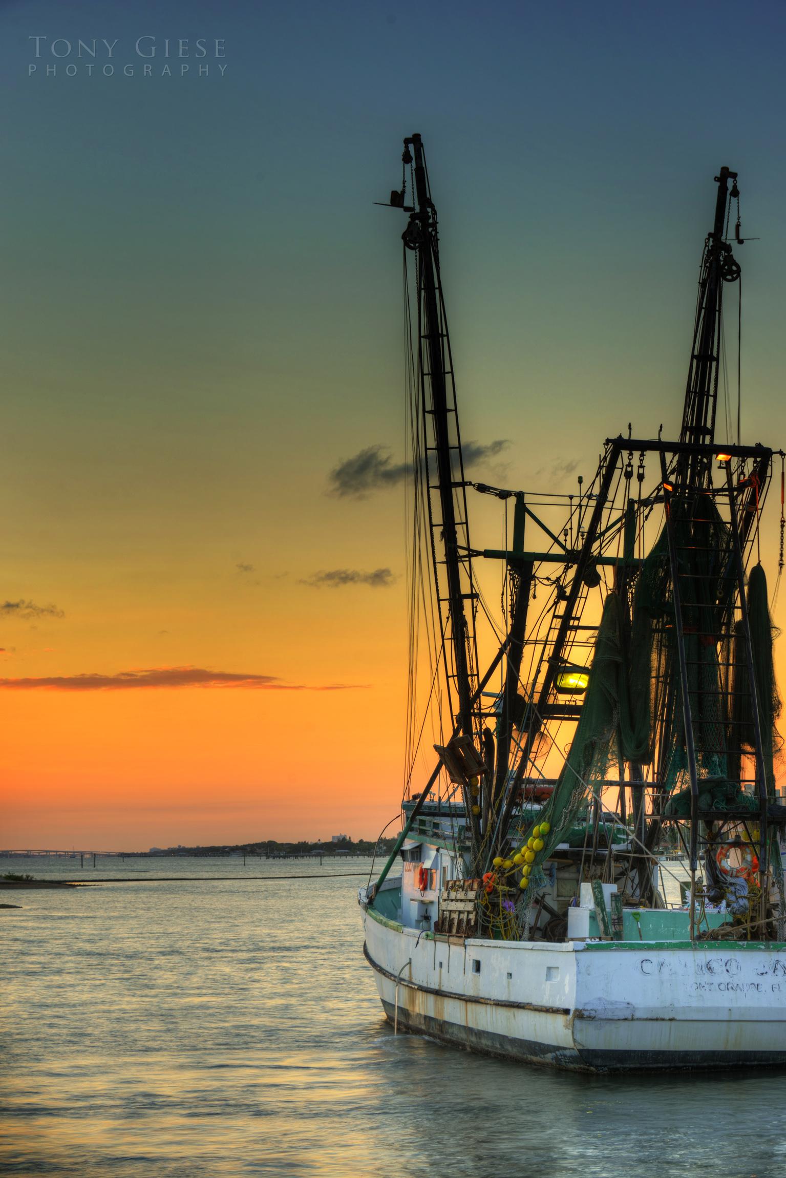Shrimp boat docked at sunset under Port Orange bridge on Halifax RIver.
